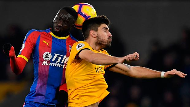 Wolves' Ruben Neves and Crystal Palace's Cheikhou Kouyate leap for the ball. Photo: Getty Images