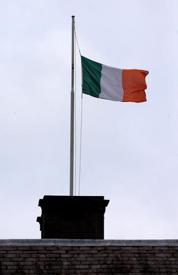 A flag flies at half mast at Leinster House, Dublin, where the Dail has gone into recess as a mark of respect to the six students who were killed in a balcony collapse in the US