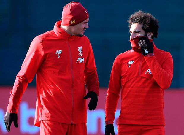 NO GO: Dejan Lovren (l) won't be in Qatar for Liverpool, but Mo Salah (r), who scored a brace on Saturday, will. Photo: Peter Byrne/PA Wire.