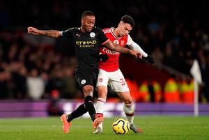 FIRST BACK: Manchester City's Raheem Sterling (left) and Arsenal's Gabriel Martinelli battle for the ball during the Premier League match at The Emirates Stadium last May. Photo: John Walton/PA Wire