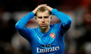 Arsenal's Per Mertesacker reacts during the defeat.    Action Images via Reuters/Carl Recine