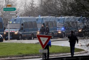 Police vans are lined up in Dammartin-en-Goele, northeast Paris, as part of an operation to seize two heavily armed suspects. (AP Photo/Michel Spingler)