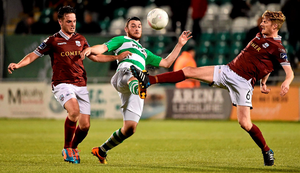 Shamrock Rovers' Ryan Brennan tries to take the ball from Conor Barry, left, and Paul Sinnott