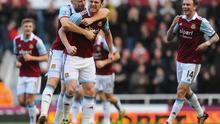 Kevin Nolan of West Ham United celebrates with James Collins (L) and Matthew Taylor (R) as he scores their first goal during the Barclays Premier League match between West Ham United and Swansea City