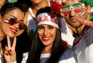 Iran supporters cheer before the Asian Cup Group C soccer match betweeen Iran and Bahrain at the Rectangular stadium in Melbourne January 11 (REUTERS/Brandon Malone)