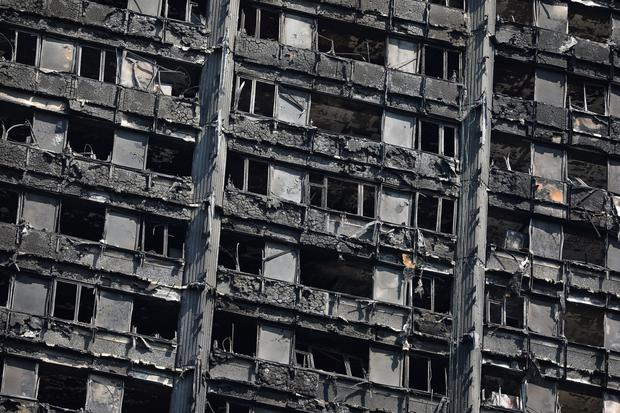 The burnt out remains of the Grenfell Tower are seen in North Kensington, London, Britain June 20, 2017. REUTERS/Marko Djurica