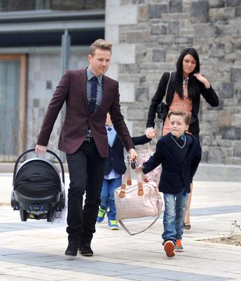 Nicky Byrne and wife Georgina arriving at St.Sylvesters Church,Malahide with their twin sons Rocco and Jay for the christening of four-month-old Gia Byrne