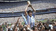 Diego Maradona holds up the World Cup in 1986 (Carlo Fumagalli/AP)
