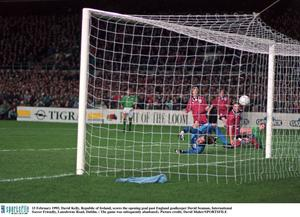 15 February 1995; David Kelly, Republic of Ireland, scores the only goal of the game against England, after which the game was abandoned due to rioting in the Upper West Stand. International Friendly, Republic of Ireland v England, Lansdowne Road, Dublin. Picture credit; David Maher / SPORTSFILE