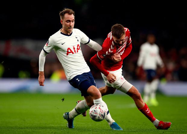 Tottenham Hotspur's Christian Eriksen (left) and Middlesbrough's Lewis Wing battle for the ball during the FA Cup third round replay match at Tottenham Hotspur Stadium, London. Photo: Tim Goode/PA Wire
