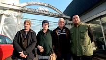 James O'Hanlon, second from right, chairman of the Dublin Greyhound Owners and Breeders Association, with dog owners and breeders, from left, Paul White, from Harold's Cross, Orla Kelly, from Naas, and Dave Traynor, from Sallins, outside the closed gates at Harold's Cross Greyhound Stadium. Photo: Caroline Quinn