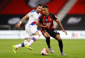 Bournemouth's Junior Stanislas in action with Crystal Palace's Luka Milivojevic. Photo: Michael Steele/Pool via Reuters