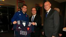 France captain Guilhem Guirado presents a French jersey to President Hollande, with FFR president Bernard Laporte looking on
