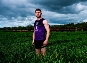 Green grass of home: Cathal McShane, pictured near his home in County Tyrone, had cut short his Australian adventure with AFL side Adelaide Crows to return to action for the Red Hand. Photo by Ramsey Cardy/Sportsfile