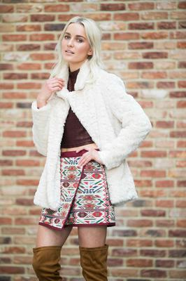 Teo wears Faux Fur Coat, €40; Aztec Skirt , €10, Burgundy Knit, €10, Tan Over the Knee Boots, €28. Photograph: Leon Farrell / Photocall Ireland