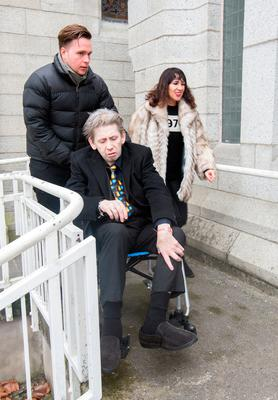 Shane MacGowan arrives with Victoria Mary Clarke at the funeral of former Pogues manager Frank Murray in St Paul's Church, Mount Argus. Photo: Tony Gavin