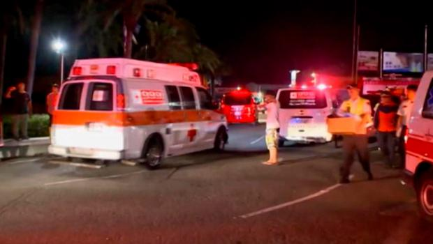 In this screen grab taken from ETTV, ambulances arrive after an accidental explosion during a music concert at the Formosa Water Park in New Taipei City, Taiwan (ETTV via AP)