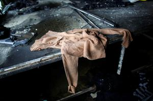 Clothes, produced in a factory belonging to Tung Hai Group, a large garment exporter, are seen after a fire in Dhaka May 9, 2013. Eight people were killed when the fire swept through the garment factory in an industrial district of the Bangladeshi capital Dhaka, police and an industry association official said on Thursday. REUTERS/Andrew Biraj (BANGLADESH - Tags: DISASTER BUSINESS TEXTILE)