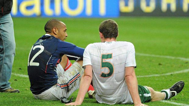 Thierry Henry with Richard Dunne after the game in Paris