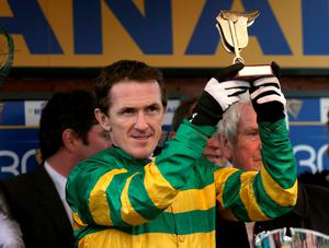 Tony McCoy lifts the trophy for the Ryanair Chase