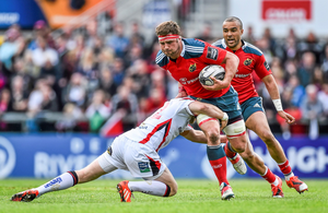 CJ Stander is tackled by Ulster's Darren Cave,at the Kingspan Stadium