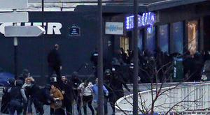 Hostages flee from the Paris grocery store after French special forces moved to end the siege