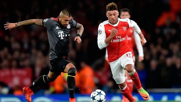 Arsenal's Alex Oxlade-Chamberlain in action against Bayern Munich's Arturo Vidal. Photo:   Hannah McKay/Reuters