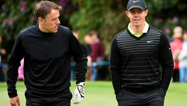 VIRGINIA WATER, ENGLAND - MAY 20:  Rory McIlroy of Northern Ireland talks with Phil Neville during the Pro-Am ahead of the BMW PGA Championship at Wentworth on May 20, 2015 in Virginia Water, England.  (Photo by Ross Kinnaird/Getty Images)