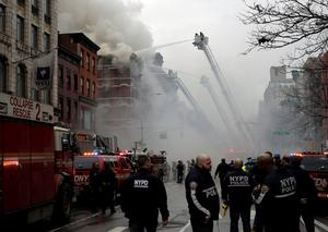 New York City Fire Department firefighters and police stand by as firefighters fight a fire at a residential apartment building in New York City. Reuters/Mike Segar