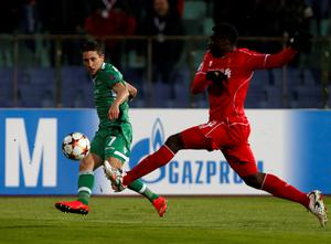 Ludogorets' Mihail Alexandrov, left, with Liverpool's Kolo Toure during the Champions League Group B soccer match between Ludogorets and Liverpool at Vassil Levski stadium in Sofia, Bulgaria (AP Photo/Darko Vojinovic)