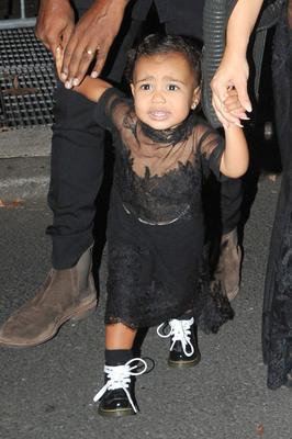 North was not happy when they cut naptime short so she could sit FROW at the Givenchy show in Paris.