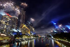Fireworks over Melbourne skyline and Yarra River during New Years Eve fireworks on December 31, 2013 in Melbourne, Australia.  (Photo by Vince Caligiuri/Getty Images)
