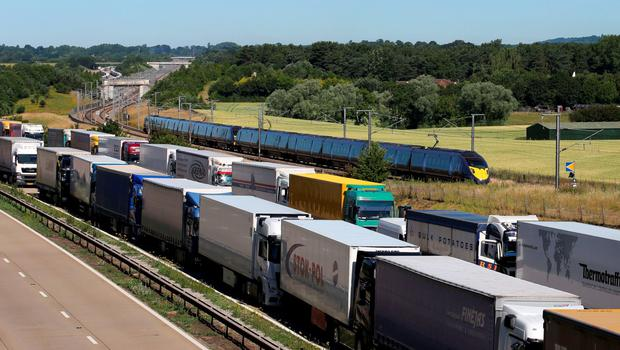 Lorries parked on the M20 near Charing in Kent as Operation Stack remains in place due to industrial action in Calais Credit: Gareth Fuller/PA Wire