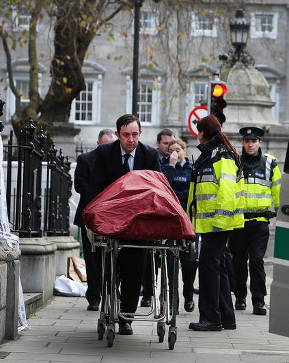 Shocking: Gardai at the scene on Molesworth Street as Jonathan Corrie's body is removed