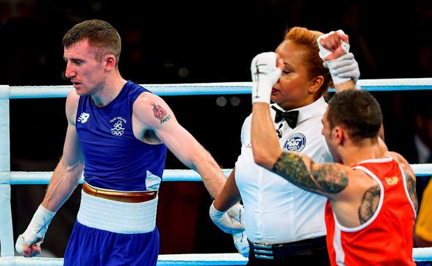 paddy Barnes of Ireland looks on as Samuel Carmona Heredia of Spain is declared victorious