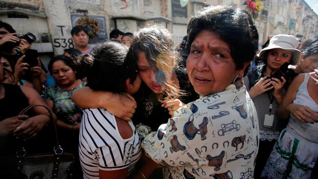 Friends and family react during the funeral of Madelin Patricia Hernandez, a victim of a fire at the Virgen de Asuncion children shelter, at the cemetery in Guatemala City, Guatemala, March 10, 2017. REUTERS/Saul Martinez