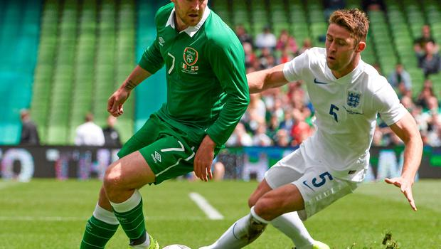 Aiden McGeady feeling the pressure from Gary Cahill