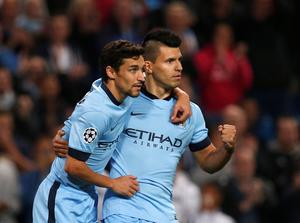 Mancheser City's Sergio Aguero (R) celebrates with team mate Jesus Navas after scoring a penalty against AS Roma during their Champions League soccer match at the Etihad Stadium in Manchester, northern England, September 30, 2014. REUTERS/Andrew Yates (BRITAIN - Tags: SPORT SOCCER)