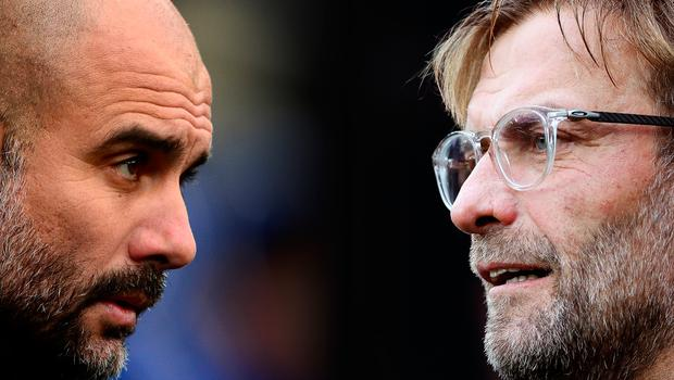 Pep Guardiola, Manager of Manchester City (L) and Liverpool manager Jurgen Klopp. (Photo by Ian MacNicol/Getty Images)