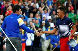 European Ryder Cup player Rory McIlroy (L) shakes hands with U.S. Ryder Cup player Rickie Fowler after winning 5&4 on the 14th green during the 40th Ryder Cup singles matches at Gleneagles in Scotland September 28, 2014.      REUTERS/Eddie Keogh (BRITAIN  - Tags: SPORT GOLF)