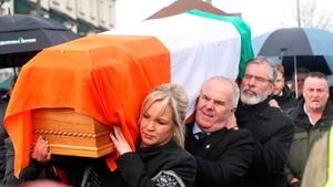 The coffin of Northern Ireland's former deputy first minister and ex-IRA commander Martin McGuinness is carried to his home by Gerry Adams, Raymond McCartney and Michelle O'Neill Photo: Niall Carson/PA Wire