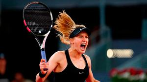 Eugenie Bouchard shows her delight after victory over Maria Sharapova. Photo by Clive Rose/Getty Images