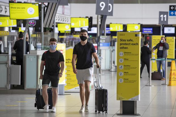 Passengers wearing face masks at Dublin Airport yesterday