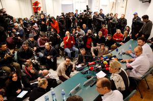 Journalists surround a table where neurosurgeon Stephan Chabardes (R), Jean-Francois Payen (2ndR), head anaesthetician at the CHU hospital, Jacqueline Hubert (3rdR), director general of the hospital, and Emmanuel Gay (4thR), head of neurosurgery, attend a news conference at the CHU hospital emergency unit in Grenoble