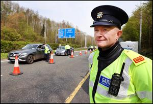 Inspector Peter Woods, from Roads Policing at Dublin Castle, oversees Garda checkpoints enforcing Covid-19 travel restrictions on the N11 at Bray Co Wicklow yesterday