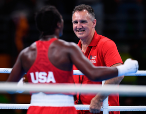 Billy Walsh greets Claressa Shields with a smile after the American wins gold in the middleweight final at the Rio Olympics. Photo: Stephen McCarthy/Sportsfile