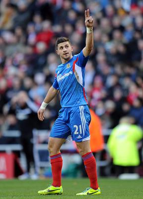 Shane Long of Hull City celebrates scoring the opening goal in their 2-0 win