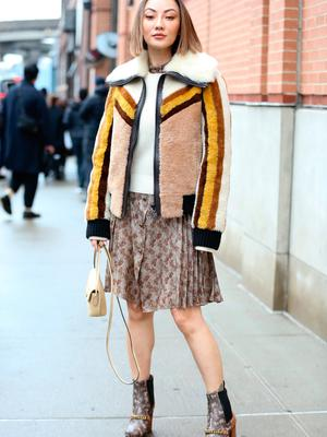Jessica Wang is seen wearing a white wool pullover, a brown jacket with wool lining, a brown skirt and beige purse outside of the Coach 1941 show during New York Fashion Week on February 11, 2020 in New York City. (Photo by Donell Woodson/Getty Images)