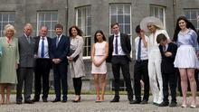 Prince Charles and Camilla with owners Constance Cassidy (left) and Eddie Walsh (4th left) and family and friends including Timothy Knatchbull (5th left) and wife Isabella (6th left) during a visit to Lissadell House, Sligo - WB Yeats's summer house - on day two of a four day visit to Ireland. Photo: Brian Lawless/PA Wire