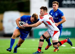 Liam Turner of Leinster A is tackled by Graham Curtis of Ulster A. Photo: Ramsey Cardy/Sportsfile